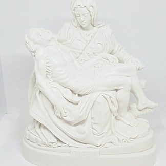 Heavy White Pieta Statue approximately 6 inches high. Made with plaster