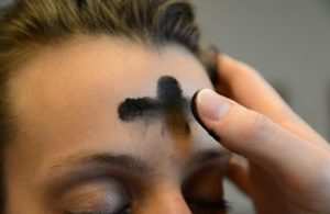 Ash Wednesday- Priest putting ashes on forehead