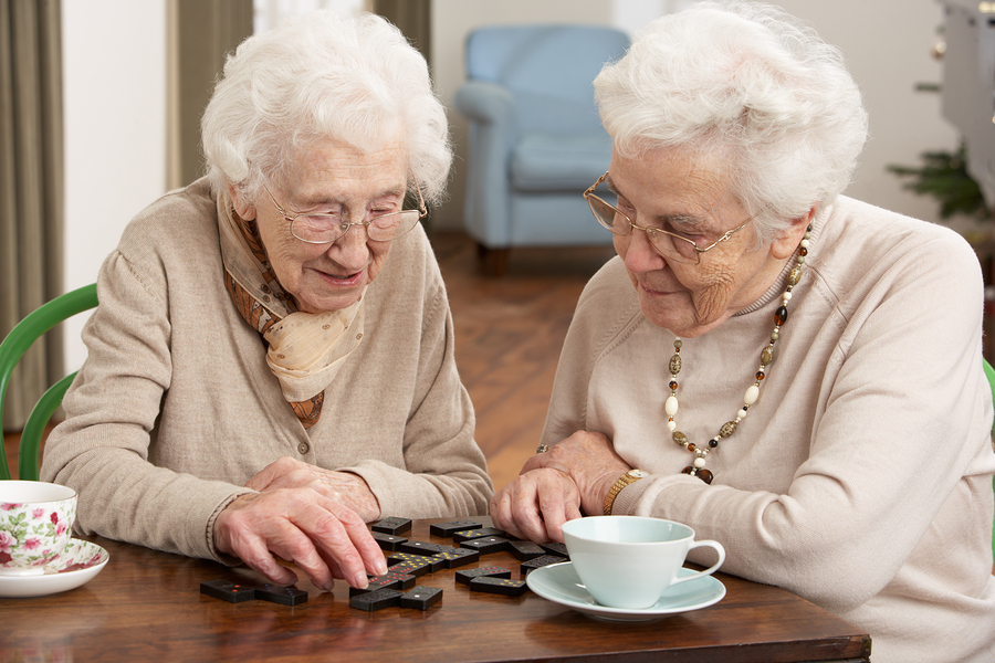elderly women playing domino